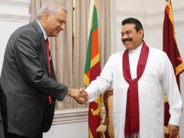 Mahinda Rajapaksa, the current Commonwealth Chair-in-Office, welcomes Commonwealth Secretary-General Mr. Kamalesh Sharma at Temple Trees, Oct. 27, 2014. (Photo by : Nalin Hewapathirana)